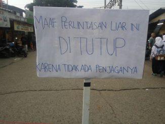 Plang peringatan Perlintasan Seadanya